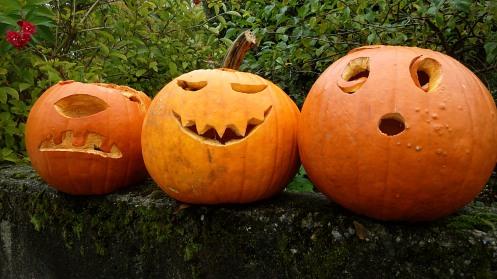 three-funny-pumpkins