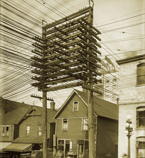 Power lines in a Vancouver back alley in 1914. -- Vancouver Archives (AM54-S4-: LGN 1241)