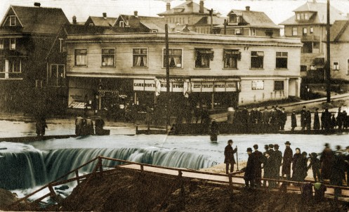 """Broadway Falls"" created when the Heather Street Creek overflowed and Cameron's Drug Store"