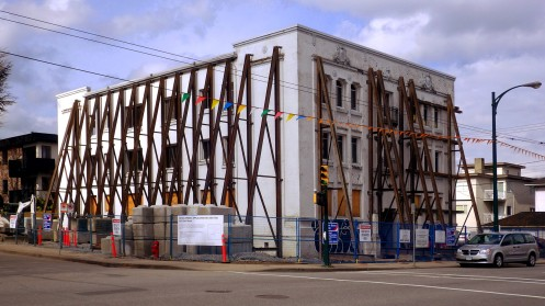 Bracing for it. Steel trusses secure the two facades to be kept.