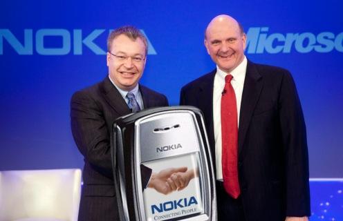 Hardware handshake. Nokia's Elop and Microsoft's Ballmer in 2014.