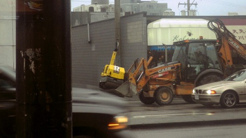 excavator-on-w-broadway-rush-hour