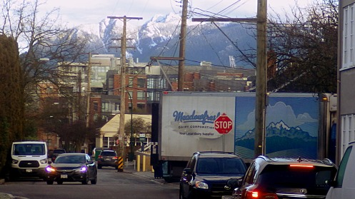 Mountains everywhere. Clear skies looking north from alley off Cambie Street.