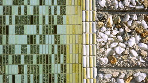 A closeup of the random-patterned tile and stone.