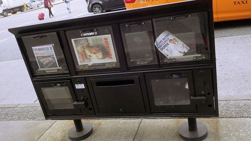 A so-called newspaper superbox on the southwest corner of West Broadway Ave. and South Granville St.
