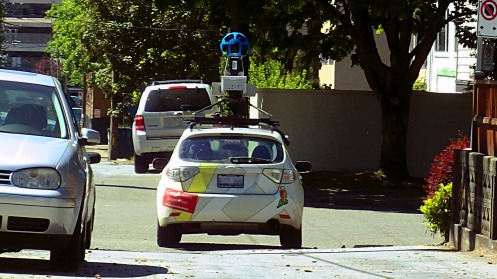 Google Maps Street View car exiting alley between 10th and 11th Ave. on to Alder St.
