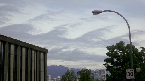 A curious repeating cloud form in the northern sky over Yukon St.