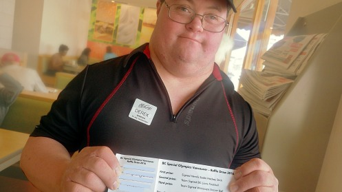 Derek with his booklet of Special Olympics raffle tickets.