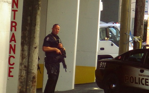 An assault rifle-toting VPD officer guards my locker at Guardian Storage.