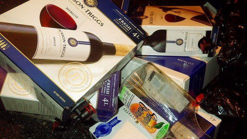 Over $2-worth of wine boxes, plus orange juice containers and some beer cans.