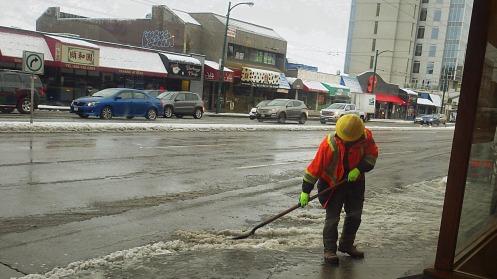 city-worker-salting-shoveling-2016-dec-05-10-26