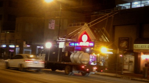 A trolley wire de-icing truck in the westbound lane of West Broadway Avenue at 9:47 p.m. Thursday.